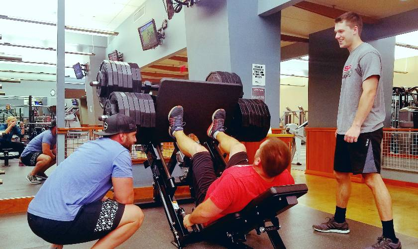 students doing leg press